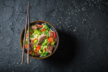 Hot asian noodle with beef and vegetables