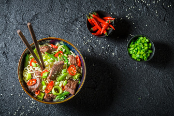 Spicy asian noodle with beef and vegetables