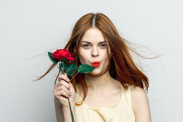 beautiful woman with red flower, bright make-up