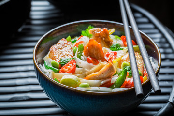 Hot noodle with vegetables, chicken and chili peppers