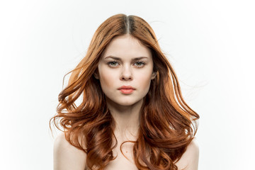 red-haired woman on a light background