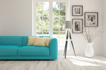 Modern interior design with sofa and green landscape in window
