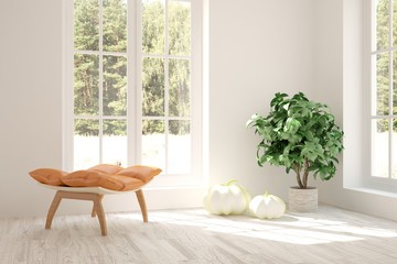 Modern interior design with chair and green landscape in window