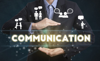 Businessman hand chooses Communication wording on interface scre