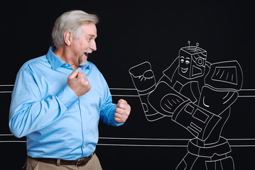 Positive joyful man fighting with a robot