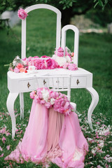 dressing table and white chair with floral decoration standing o