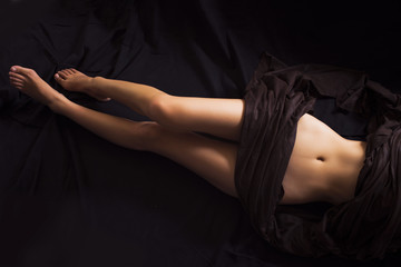 Sexy woman lying down, features slim belly