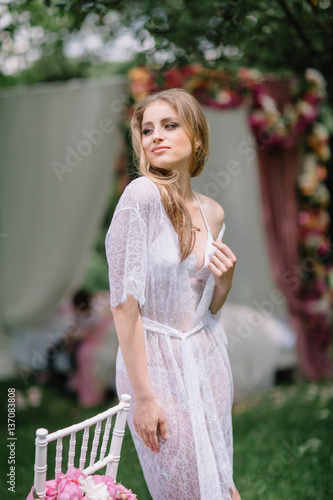 f372696a70 beautiful young woman in white nightgown standing outdoors