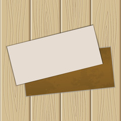 The sheet of paper on a wooden background