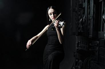 Beautiful woman playing the violin, art, emotions