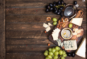Grapes Red Wine Cheeses Honey And Nuts Over Rustic Weathered Wood