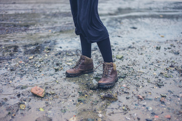 Woman wearing hiking boots in the mud