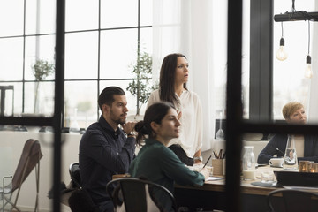 Business man and woman listening during meeting at office
