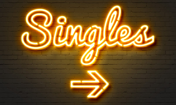Singles neon sign on brick wall background.
