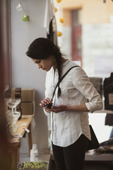 Side view of customer holding consilium vas while standing at store