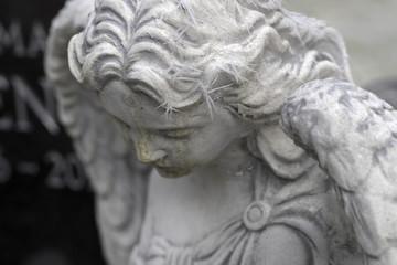 Cemetry in winter. Angel