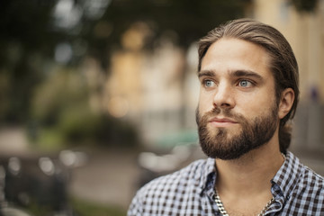 Close-up of man with beard looking away