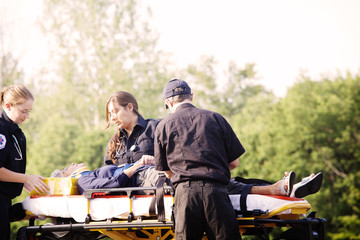 Senior woman lying down on stretcher