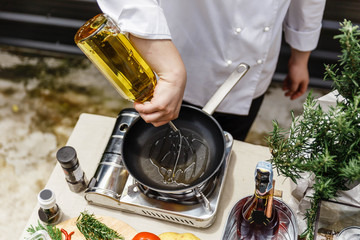 Chef Preparing Olive Oil in a Pan for Making Rosemary Oil.