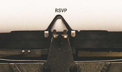 RSVP Text on paper in vintage type writer from 1920s