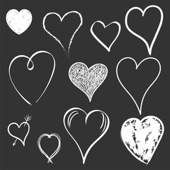 Hearts icon set. Love hand drawn vector illustration on black background.