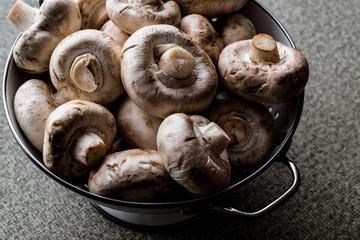 Raw Mushrooms in colander.