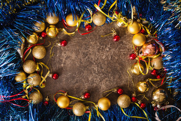 Frame of Christmas toys on table. Celebrate the New Year. Flat lay, top view, copyspace