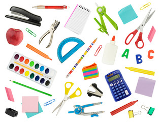 Arrangement of various school supplies, isolated on white. Suitable for use as a back-to-school background.