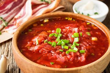 Beet soup borscht  with garlic buns and cured pork belly, Ukrainian cuisine