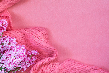Beautiful spring holiday background. Fresh white hyacinth and pink woven scarf on pink copy space groundwork.