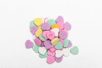 A pile of heart shaped candies being used as a marriage proposal