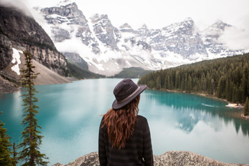 Woman looking at view of lake and mountains, Banff National Park, Alberta, Canada