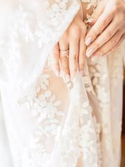 Wedding. Bride in boudoir dress. Wedding Ring on hand