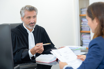 woman signing contract in lawyers office