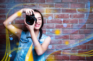 Professional photographer on brick wall background. Creative design