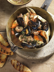 Pan of cioppino and toasted bread