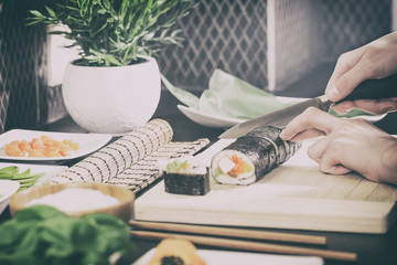 The chef prepares sushi.
