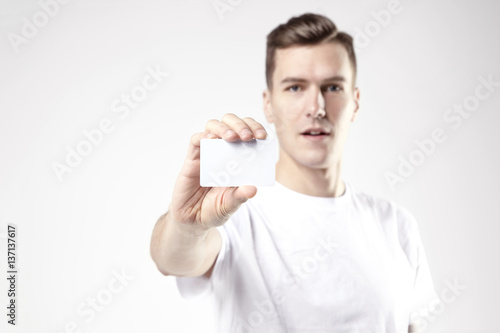 Portrait of attractive businessman holding blank business card portrait of attractive businessman holding blank business card empty space for layout with white colourmoves