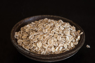 Rolled barley flakes in a pottery bowl