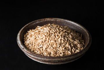 Oat groats in a pottery bowl