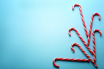 Sweet candy canes on light blue background