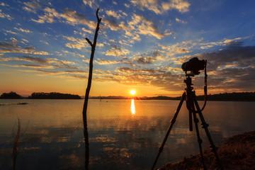 Take photo at the lake in sunset time
