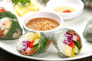 Spring rolls made from fresh vegetables and meat with peanut butter sauce