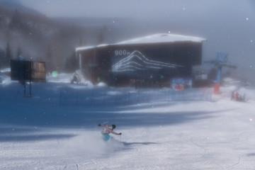 Skier slides down the snowy hill