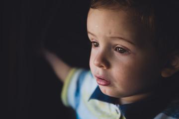 Horizontal studio portrait of young little boy.