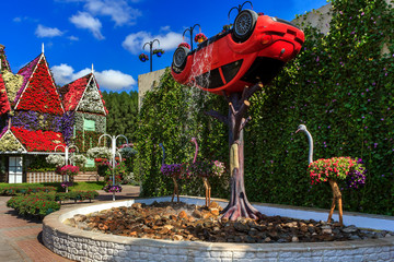 Dubai Miracle Garden - Landscape flower arrangement with a car and a fountain.  Dubai Miracle Garden is the largest natural flower garden in the world