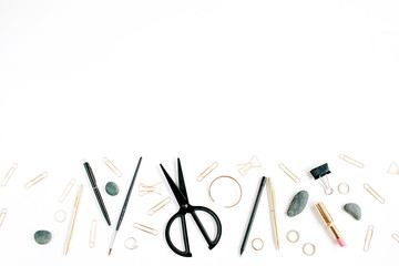 Home office workspace with scissors, clips and female accessories. Flat lay, top view. Blog header or hero.