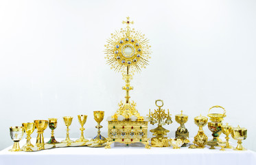 Golden holy religious equipment on white background