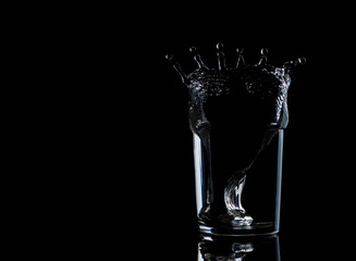 Water in glass with water splash energy