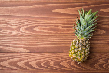 Fresh pineapple on wooden table